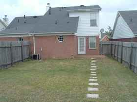 Fenced Back Yard leads to Rear Parking Pad